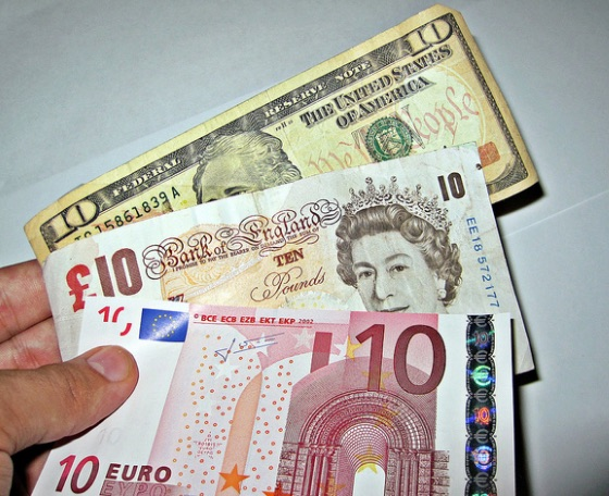 currency_exchange___a_person_holding_three_different_foreign___flickr