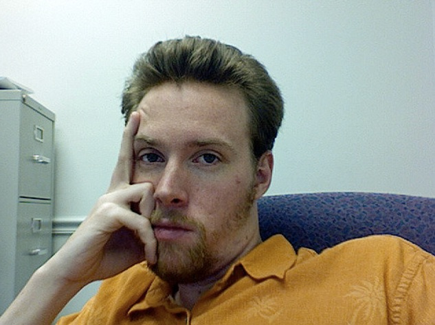 Bored_at_work___I_needed_some_actual_pictures_of_myself___Phil_Kates___Flickr